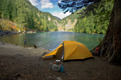 Fisherman camping at a wilderness lake
